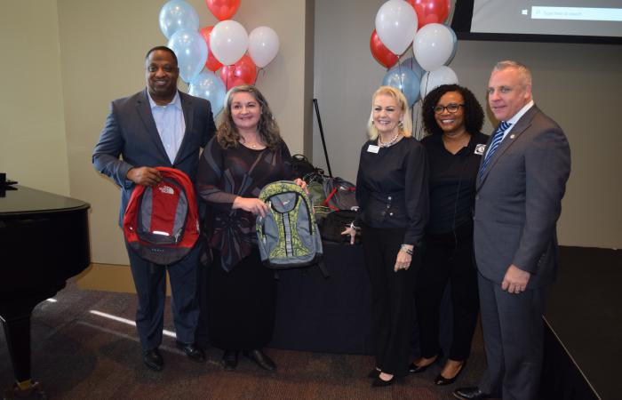 Members of the Georgia Commission for Service and Volunteerism and Veterans Empowerment Organization pose with backpacks from a service project.