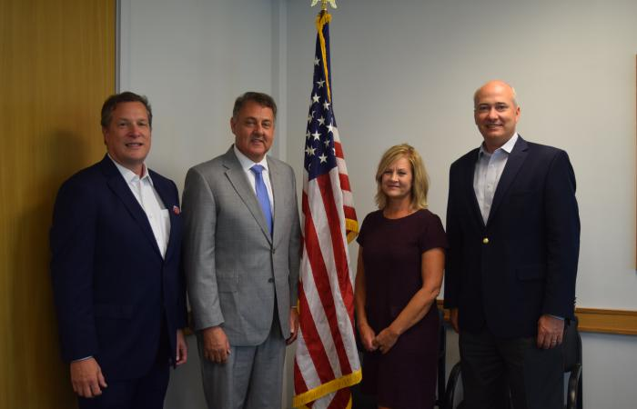 From left are Georgia Technology Authority Chief Information Office Calvin Rhodes, Sen. Steve Gooch, Broadband Executive Director Deana Perry, and DCA Commissioner Christopher Nunn.