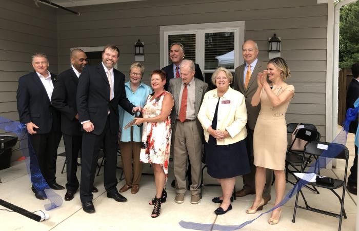 3Keys CEO Darlene Schultz is surrounded by state legislators and government officials during the Rosalynn Apartments reopening ceremony.