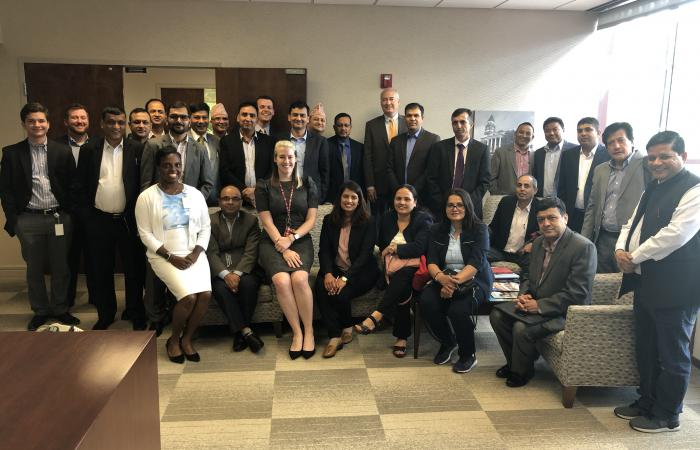 Nepalese Finance Ministry members pose with DCA staff during their visit to the agency