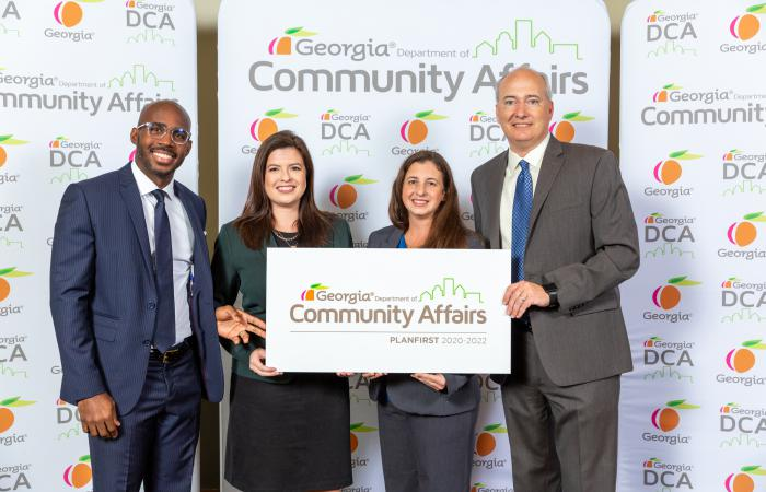 PlanFirst community members from Powder Springs pose with DCA Commissioner Christopher Nunn.