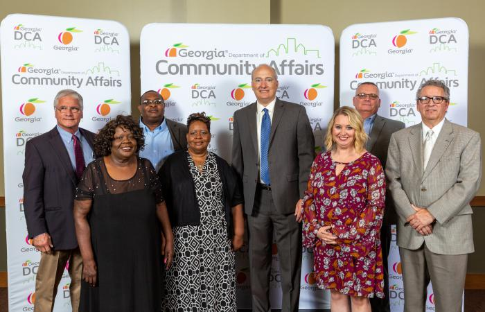 Members of the City of Adel pose with DCA Commissioner Christopher Nunn. Adel received a GA Initiative for Community Housing designation.